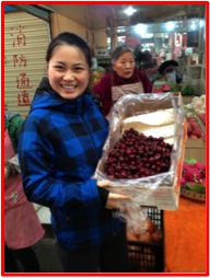A happy customer with  hard to find the cherries from Australia