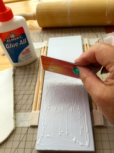 spread out the glue with a credit card