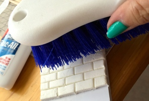 Use a stiff-bristle brush to age the surfaces